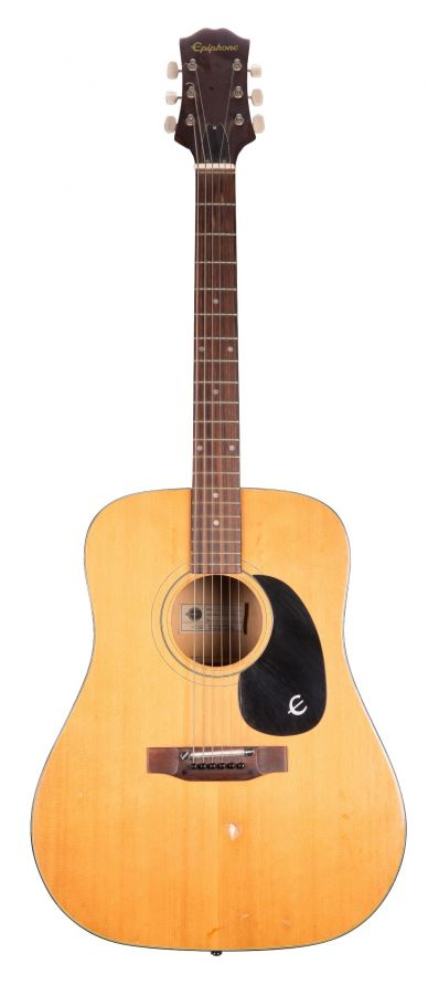 Lot Number 203. Epiphone FT-140 acoustic guitar, made in Japan, large impact blemish to top, various other untidy areas, gig bag. Auctioned at The Guitar Auction on 11th March 2020