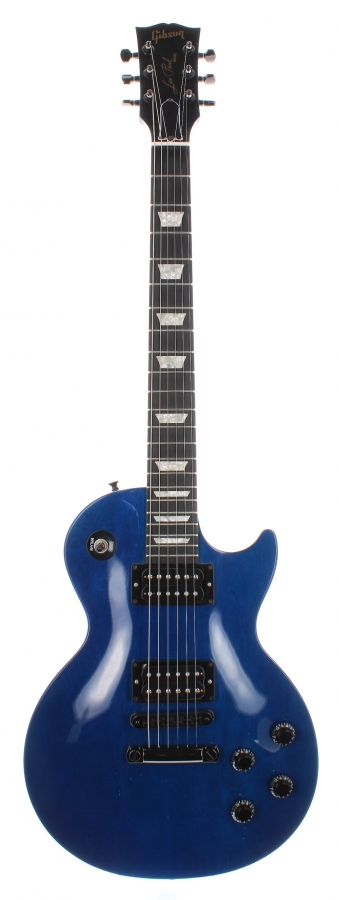 Lot Number 407. The Edge (U2) - 1997 Gibson Les Paul Studio electric guitar, made in USA, ser. no. 92057524, blue finish *Given to RTL, France's biggest radio station, by U2's Edge. The guitar was offered as a competition prize to coincide with U2's appearance at Parc des Princes on 6th September 1997. The guitar bears a brass plaque to the back inscribed 'Souvenier du Concert du Parc des Princes, U2-RTL 2, 6-9-97'.  Also sold with the competition winning RTL 2 flyer stating (converted from French) 'Win the guitar of the concert U2.  RTL 2 brings you the Gibson Les Paul guitar from Edge'. Auctioned at The Guitar Auction on 9th December 2020