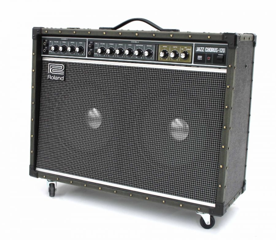 Lot Number 660. Roland Jazz Chorus JC-120B guitar amplifier, made in Japan, ser. no. A7E7524, with two Boss foot switches, dust cover and original purchase receipt. Auctioned at Entertainment Memorabilia, Guitar Amps & Effects on 12th March 2020