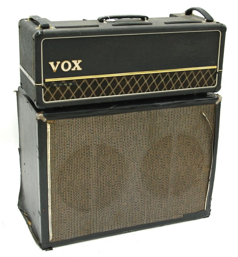 Lot Number 555. Mid 1960s Vox AC30B Bass guitar amplifier head (combo conversion), made in England, ser. no. 17663, chassis ser. no. 9995,  together with a custom made twin speaker cabinet housing two Vox Silver Bell speakers (requires servicing). Auctioned at Entertainment Memorabilia, Guitar Amps & Effects on 10th September 2020