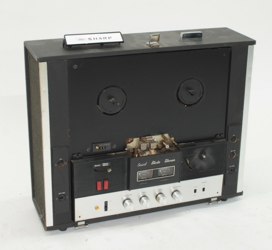 Lot Number 1061. WITHDRAWN FROM SALE (PAT failure) Sharp RD-711D reel-to-reel tape recorder, made in Japan, ser. no. 91208552, in need of some attention. Auctioned at Entertainment Memorabilia, Guitar Amps & Effects - Including The Bernie Marsden Collection: Part I on 10th December 2020