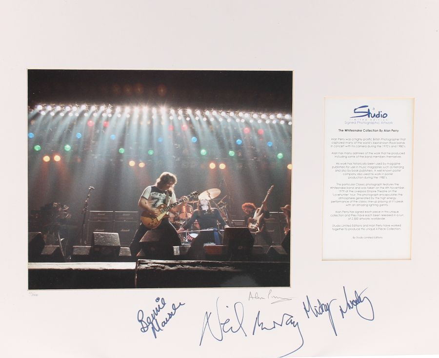 Lot Number 566. Bernie Marsden - Alan Perry 'The Whitesnake Collection' signed photographic artwork, limited edition 101/2500, autographed by Bernie Marsden, Neil Murray, Micky Moody and Alan Perry *Alan Perry is a prolific British photographer who captured many of the world's best known rock bands in concert with his camera during the 1970s and 1980s.  This particular photograph features the Whitesnake band and was taken on 4th November 1979 at the Liverpool Empire theatre on the 'Love Hunter' tour.  The photograph encapsulates the atmosphere generated by the high energy performance of the classic line-up playing at its peak with its amazing lighting gantry. Auctioned at Entertainment Memorabilia, Guitar Amps & Effects - Including The Bernie Marsden Collection: Part I on 10th December 2020