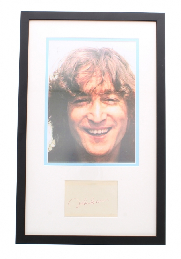 Lot Number 610. John Lennon - 1970s autograph, within a mounted framed display, 19.5