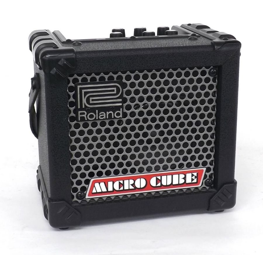 Lot Number 660. Roland Micro Cube guitar amplifier. Auctioned at Vinyl, Memorabilia, Guitar Amps, Effects & Audio on 12th September 2019