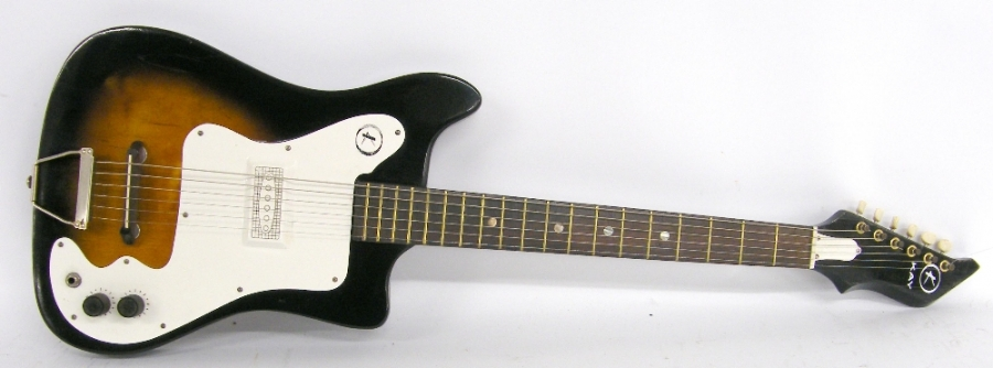Lot Number 178. 1960s Kay K310 electric guitar, made in USA, two-tone sunburst finish with typical wear for age, re-fret, electrics in working order, condition: fair. Auctioned at The Guitar Auction - Including the Perry Bamonte (The Cure) Collection on 14th September 2017