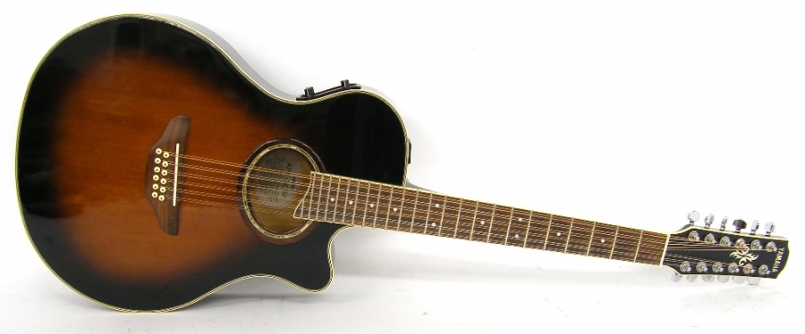Lot Number 198. Yamaha APX-AC12 twelve string electro-acoustic guitar, vintage sunburst finish with various surface scratches, electrics in working order, condition: good. Auctioned at The Guitar Auction - Including the Perry Bamonte (The Cure) Collection on 14th September 2017