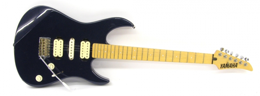 Lot Number 218. Yamaha 121DM electric guitar, metallic blue finish with many imperfections including dents and scratches to the lacquer, electrics in working order, soft case, condition: fair. Auctioned at The Guitar Auction - Including the Perry Bamonte (The Cure) Collection on 14th September 2017