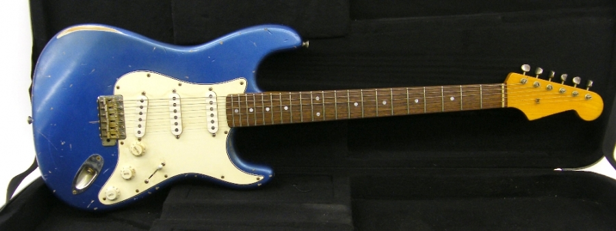 Lot Number 297. 2007 Bill Nash S63 electric guitar, ser. no. 1xxxx9, Lake Placid blue relic finish, electrics in working order, original case, condition: good. Auctioned at The Guitar Auction - Including the Perry Bamonte (The Cure) Collection on 14th September 2017