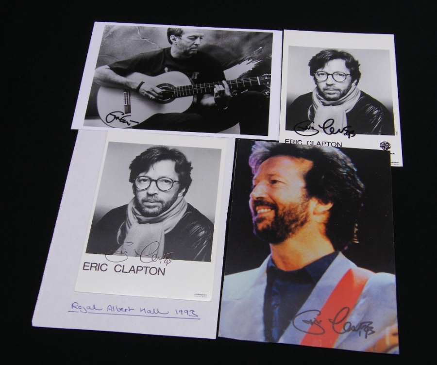 Lot Number 395. Four autographed Eric Clapton photographs *One autograph obtained at a Royal Albert Hall performance in 1993. The other three are promotional photographs, signed by Eric and released to fans. Auctioned at The Guitar Auction - Including the Perry Bamonte (The Cure) Collection on 14th September 2017