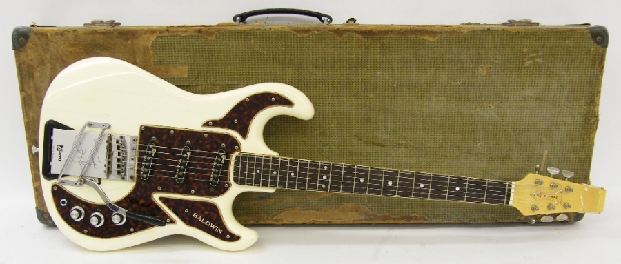 Lot Number 112. Burns/Baldwin Marvin electric guitar, made in England, circa 1967, with white inspection sticker under the guard dated 20th February 1967, ser. no. 2xxx4, white finish with typical lacquer checking and other various imperfections, blemishes to lacquer on the back of the neck, wear to frets, replaced switch tip, electrics in working order, hard case, condition: good for age *The vendor bought this guitar from the original owner in 1994  **Sold with CITES certificate no. 555097/01. Auctioned at The Guitar Auction - Including the Mark Griffiths (The Shadows) Collection on 15th June 2017