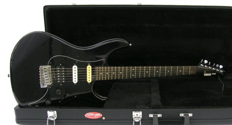 Lot Number 188. Yamaha SE112 electric guitar, made in Taiwan, ser. no. NM2xxx6, black finish body with many impact blemishes and other surface marks, replaced neck and middle pickup (originals retained), wear to fretboard, electrics in working order, hard case, condition: fair. Auctioned at The Guitar Auction - Including the Mark Griffiths (The Shadows) Collection on 15th June 2017