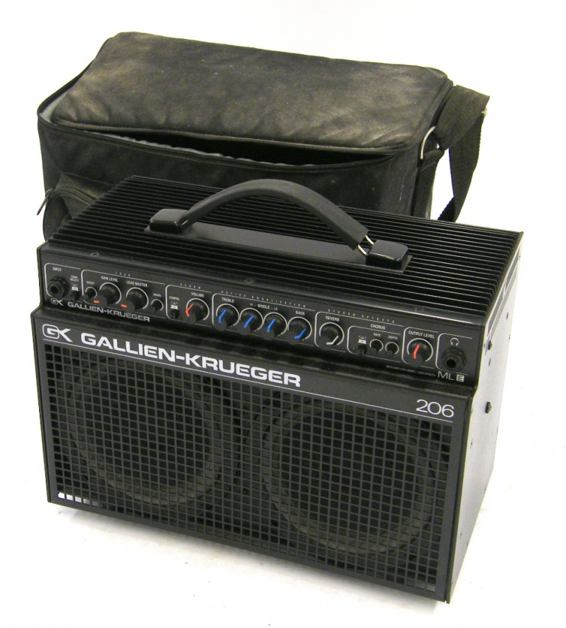 Lot Number 312. Gallien-Krueger MLE 206 guitar amplifier, made in USA, ser. no. 93764, with a vintage cabinet voicing module unit, carry case (hole to right hand speaker). Auctioned at The Guitar Auction - Including the Mark Griffiths (The Shadows) Collection on 15th June 2017