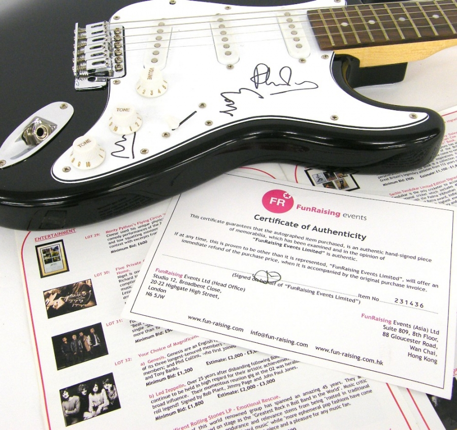 Lot Number 55. Genesis autographed Shine electric guitar, signed by Phil Collins, Mike Rutherford and Tony Banks to the scratchplate *Won at a silent auction on Wednesday 16th January 2013 held by Fun Raising Events, listed as lot 32 with a minimum bid of �1200 and an estimate of �2000-3000.  The guitar comes with the catalogue for the event and certificate of authenticity. Auctioned at The Guitar Auction - Including the Mark Griffiths (The Shadows) Collection on 15th June 2017