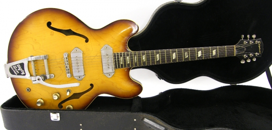 Lot Number 58. 1964 Epiphone E230TD Casino hollow body electric guitar, made in USA, ser. no. 1xxxx5, sunburst finish with various wear to include lacquer checking, blemishes and other surface marks, wear to the back of the neck, wear and oxidisation to frets, missing pickguard, empty holes to the body from where a left-handed pickguard was once situated, replaced nut, old screw holes left from an old Humbucker installation, current pickups incorrect, electrics in working order, later Epiphone hard case, condition: poor *Sold with CITES article 10 certificate no. 551935/02. Auctioned at The Guitar Auction - Including The Geoff Banks Collection on 16th March 2017