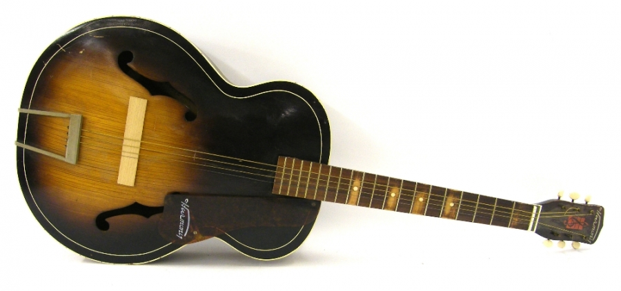 Lot Number 73. 1940s/50s Harmony H1215 Archtone acoustic archtop guitar, sunburst finish with wear as to be expected for age, rubbing to fretboard, incorrect nut, missing bridge, condition: fair. Auctioned at The Guitar Auction - Including The Geoff Banks Collection on 16th March 2017