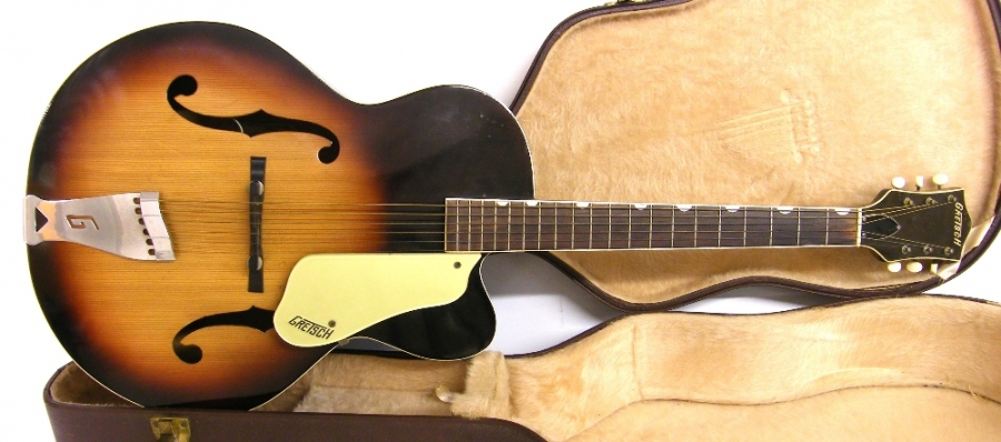 Lot Number 137. 1958 Gretsch 6014 Corsair archtop guitar, sunburst finish in good condition for age, minor dent wear to frets, deterioration to the binding around the heel of the neck, internal electrics in working order, hard case, condition: good *Sold with CITES article 10 certificate no. 549907/01.  This lot is subject to CITES regulations if exporting outside of the EU. Auctioned at The Guitar Auction on 8th December 2016