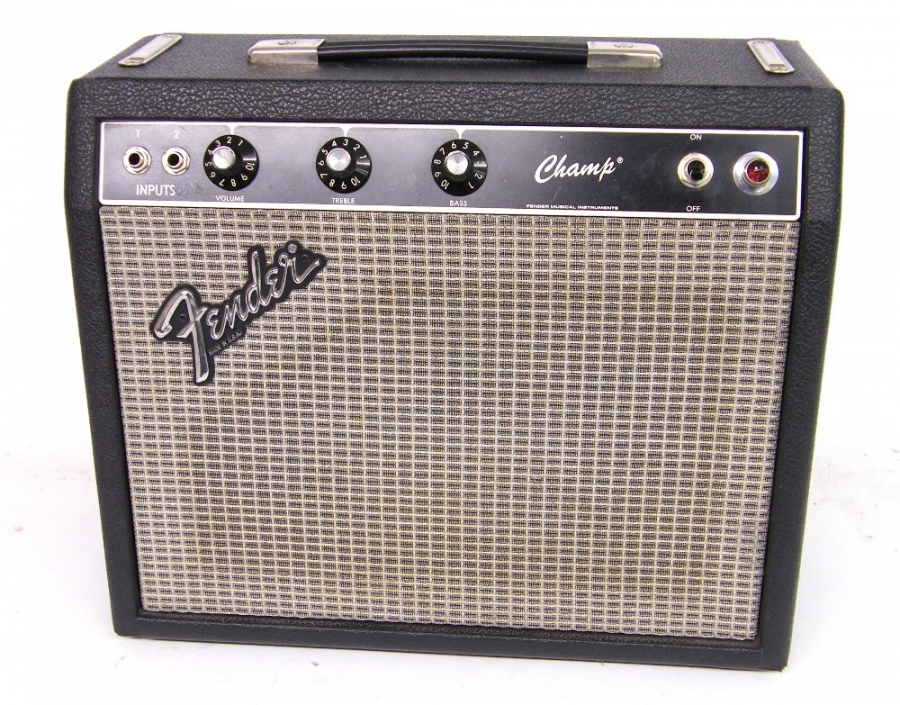 Lot Number 283. 1980s Fender Blackface Champ guitar amplifier, made in USA, ser. no. F148196, in working order. Auctioned at The Guitar Auction on 8th December 2016