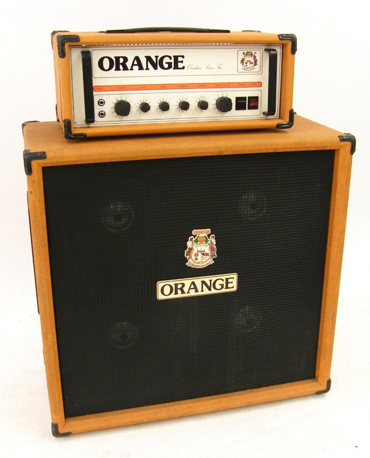 Lot Number 313. Orange Overdrive Series 2 model no. OR1112M amplifier head, made in England, ser. no. 016233 and 4 x 12 speaker cabinet, ser. no. 8435, appears to be working. Auctioned at The Guitar Auction on 8th December 2016