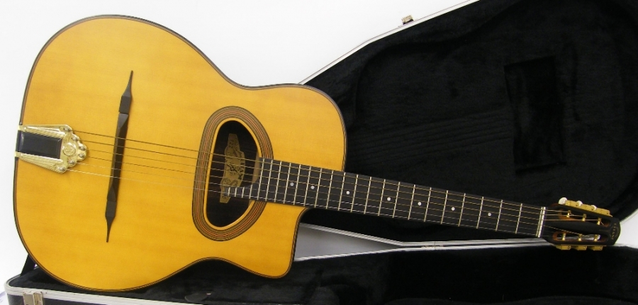Lot Number 132. Gitane D-500 Gypsy Jazz acoustic guitar, numbered 122 to the label, also numbered 0204080195 to the block, Indian rosewood back and sides, natural finish top, hard case, condition: good. Auctioned at The Guitar Auction on 15th September 2016