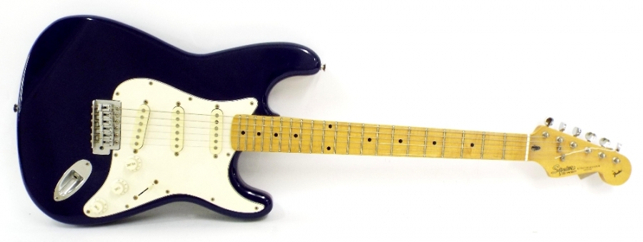 Lot Number 187. Squier by Fender Stratocaster electric guitar, made in Korea, ser. no. VN705277, blue finish with minor imperfections, electrics in working order, soft case, condition: good. Auctioned at The Guitar Auction on 15th September 2016
