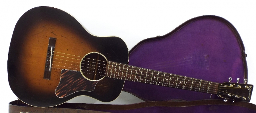 Lot Number 202. Late 1930s/early 1940s Kalamazoo by Gibson KG acoustic guitar, sunburst finish, re-finished to back, sides and edges of table, lots of wear as typical for age and model, replaced tuners, later pickguard, original case, condition: fair. Auctioned at The Guitar Auction on 15th September 2016