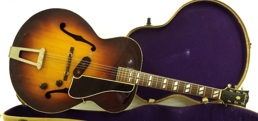 Lot Number 210. 1941 Gibson ES300 electric archtop guitar, made in USA, ser. no 9xxx0, sunburst finish with surface marks and blemishes to be expected for age, electrics in working order, blonde tweed hard case, condition: good for age. Auctioned at The Guitar Auction on 15th September 2016