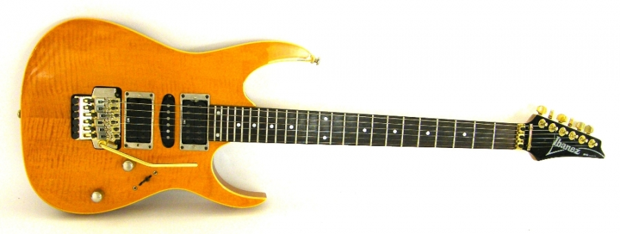 Lot Number 239. Ibanez RG series RG470 FRM electric guitar, made in Korea, ser. no. C6035286, amber finish with some minor imperfections, electrics appear to be in working order, condition: good. Auctioned at The Guitar Auction on 15th September 2016