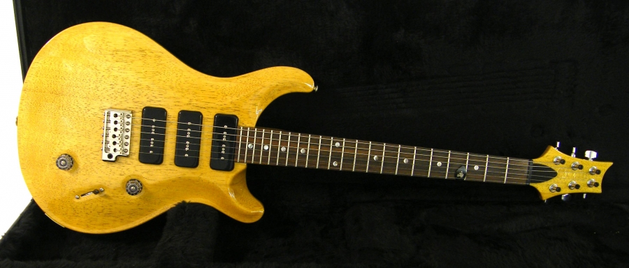 Lot Number 3. 2009 Paul Reed Smith (PRS) KL380 Korina electric guitar, ser. no. 145678, vintage natural finish, electrics appear to be in working order, hard case and candy, condition: good. Auctioned at The Guitar Auction on 10th March 2016