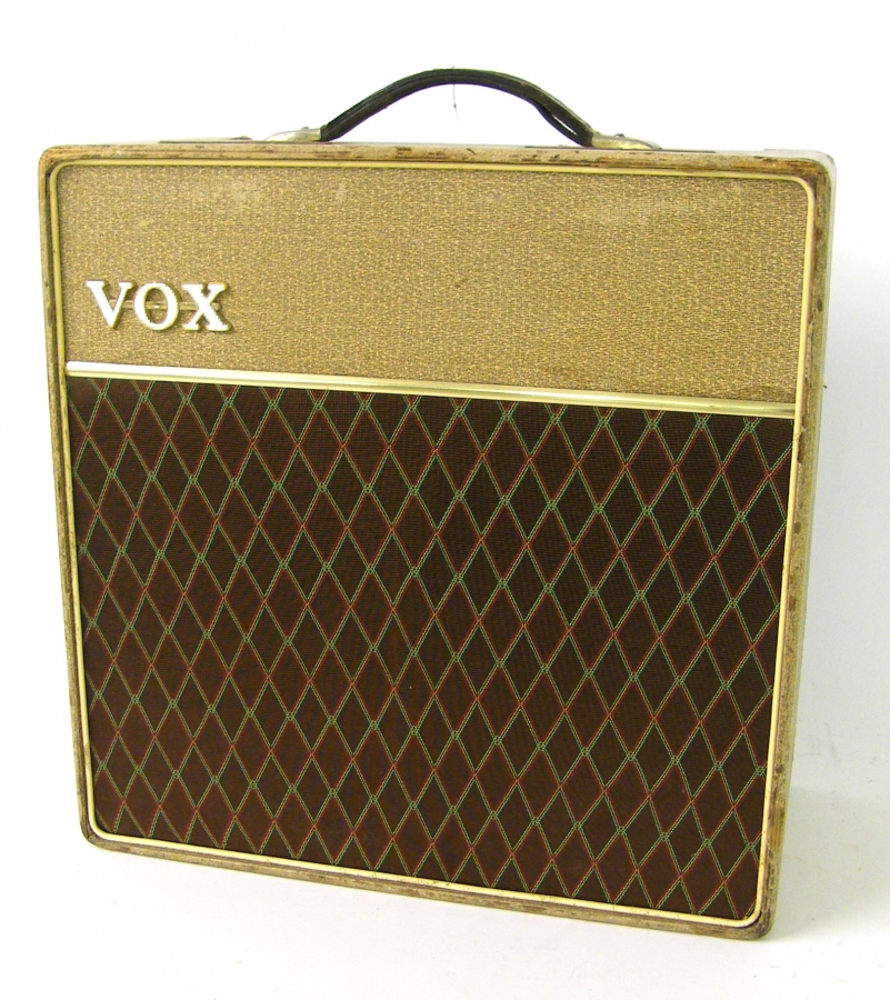 Lot Number 310. 1961 Vox AC15 guitar amplifier, made in England, ser. no. 4376/N, black and gold highlighted control panel, replaced grille cloth, replaced speaker, electrics working, but in need of attention. Auctioned at The Guitar Auction on 10th March 2016