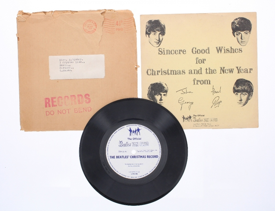 Lot Number 680. The Beatles - a rare original 'Official Beatles Fan Club' 33 1/3 rpm 'The Beatles Christmas Record' flex disc with original gatefold cover, within the original shipping envelope with London postmark dated 26th January 1964. Auctioned at Memorabilia, Guitar Amps, Effects & Audio on 13th June 2019