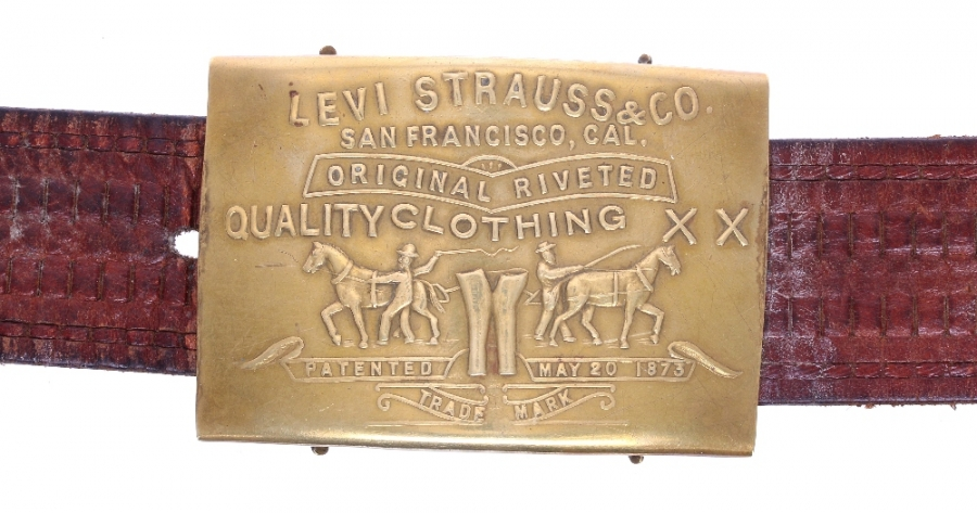 Lot Number 697. Jimi Hendrix - Levi Strauss & Co brass belt buckle, formerly owned and worn by Jimi Hendrix, circa 1967 Provenance: Ex lot 672 - Bonhams, 16th November 2005 - Rock 'n' Roll & Film Memorabilia. The Levi's buckle was part of lot 672 described in the original catalogue listing as