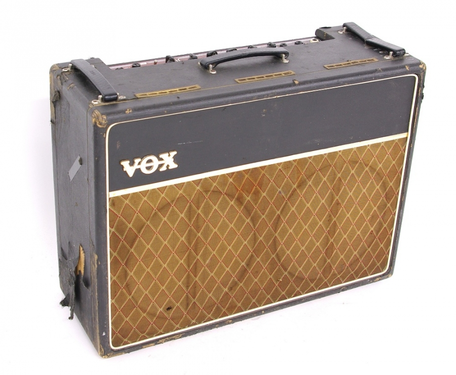 Lot Number 843. Early 1960s Vox AC30 guitar amplifier, made in England, ser. no. 7612N, copper control panel, blue back speakers. Auctioned at Memorabilia, Guitar Amps, Effects & Audio on 13th June 2019