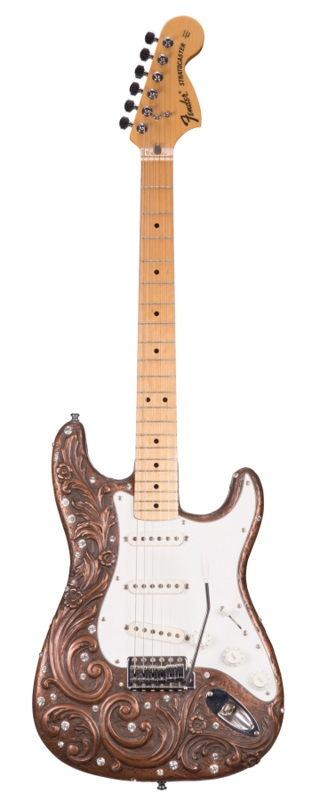Lot Number 346. Jon Douglas Rhinestone Stratocaster - an acanthus carved body with applied rhinestones, united with a Fender Japan '70s reissue maple board neck *From the collection of Keith Smart - In the 1970s Ivor Arbiter of Fender UK commissioned sculptor and neighbour, Jon Douglas, to cast a number of Strat bodies.  Most were destroyed in a fire at the Soho Sound House, a half dozen survived.  In the 1990s Keith commissioned Jon to cast a further twenty-seven, these are slightly different to the '70s versions.  They have the seal of authenticity with their edition number on the reverse.  This is Keith's personal guitar, built with a Fender Japan '70s donor neck.  Jon has a full-size sculpture of Winston Churchill in The Savoy's Churchill room, he also has a full-size Sherlock Holmes in The Holmes Museum in Baker Street.  Sold with various paperwork regarding Jon Douglas. Auctioned at The Guitar Auction - Including the Frank Allen Collection on 12th December 2018