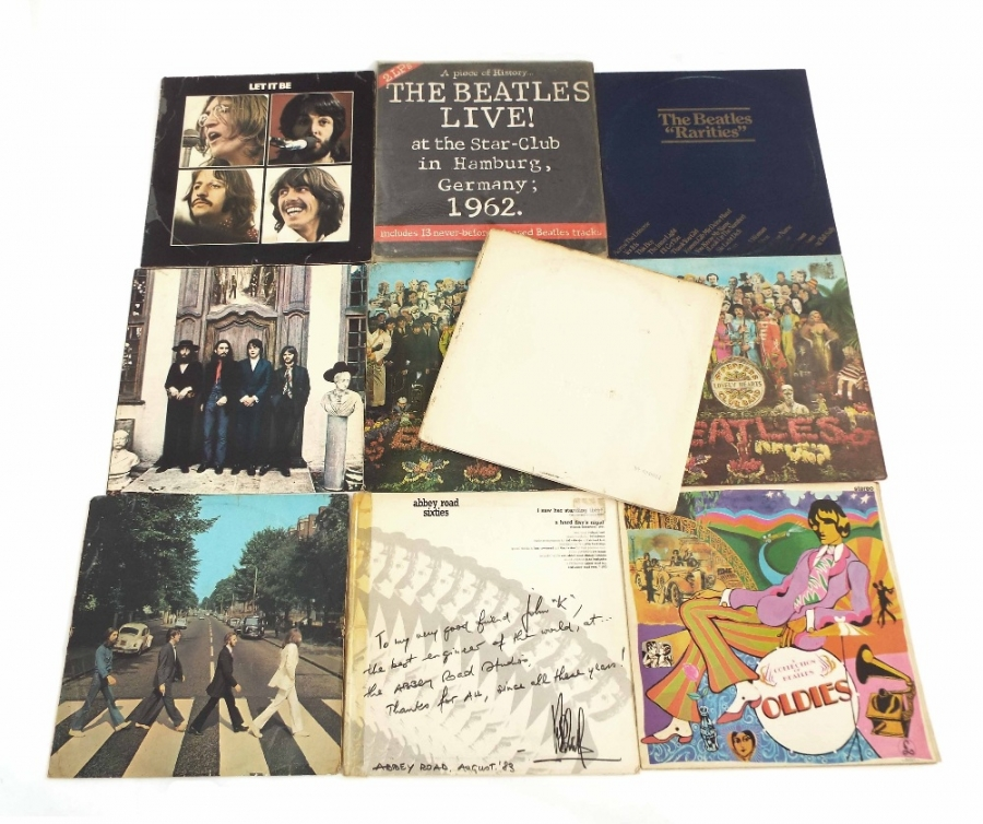 Lot Number 13. The Beatles - nine vinyl LP records, White Album, first pressing Top 348, 874, vinyl VG, Abbey Road, first pressing, vinyl VG, Sgt Pepper's Lonely Hearts Club Band, mono, first pressing, cutouts etc, conditions vary, vinyl mostly VG, some EX. Auctioned at The Guitar Auction - Including Music Memorabilia on 12th September 2018