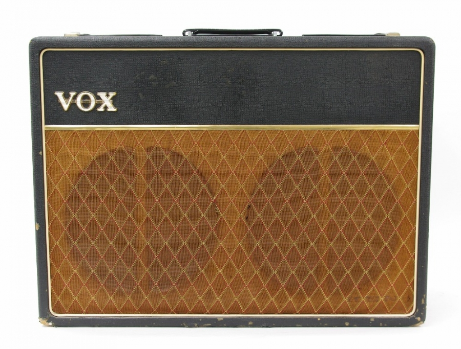 Lot Number 637. 1963/64 Vox AC30 guitar amplifier, made in England, ser. no. 15050T, with copper top panel, original Celestion silver speakers and egg foot switch, replaced upper side handles, small tears to the original grille cloth, serviced by Gee Electronics in 2007 with some small electrical parts and cable renewed (parts retained), in working order. Auctioned at The Guitar Auction - Including Music Memorabilia on 12th September 2018