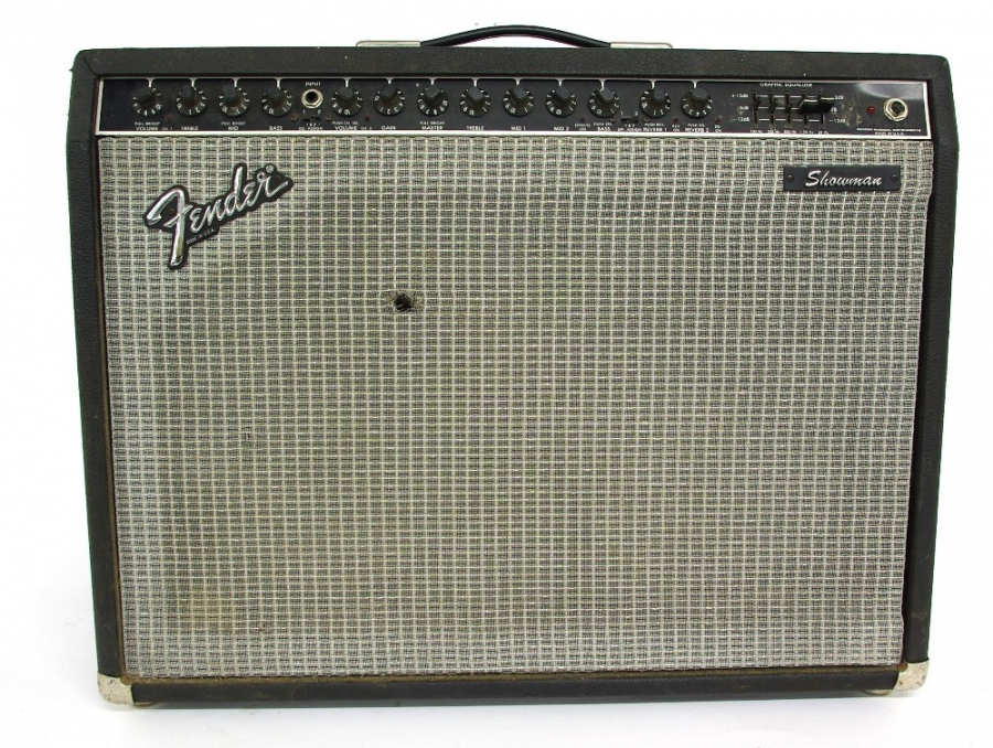 Lot Number 405. 1983 Fender Showman guitar amplifier, made in USA, ser. no. F308728, tolex in tired condition, rip to front grille, appears to be in working order, although attention required to input jack which is intermittent. Auctioned at The Guitar Auction on 14th June 2018