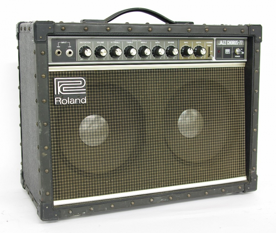 Lot Number 437. Roland Jazz Chorus JC-77 guitar amplifier, made in Japan, ser. no. 572096, in working order. Auctioned at The Guitar Auction on 14th June 2018