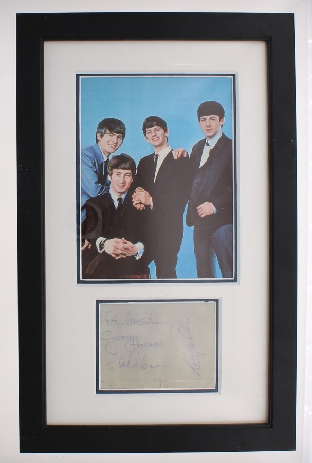 Lot Number 522. The Beatles - autographed page mounted within a framed display below a picture of the Fab Four *Obtained in Blackpool on the 26th July 1964, 21