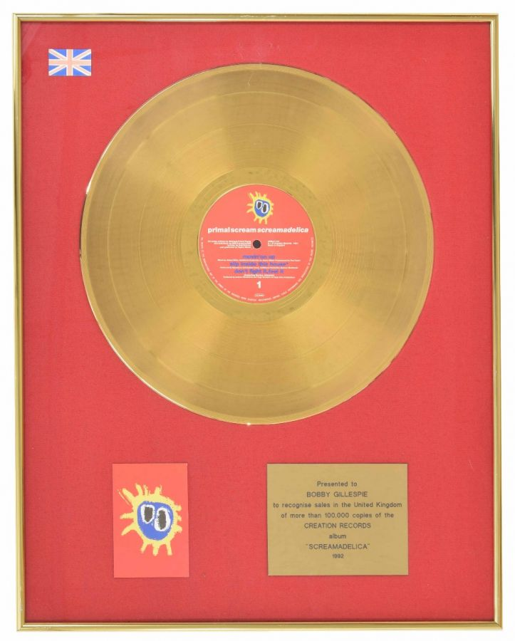 Lot Number 535. Primal Scream - 'Screamadelica' gold and silver presentation discs, presented to Bobby Gillespie in recognition of 60,000 and 100,000 sales for the 1992 Creation Records album 'Screamadelica', each mounted within a presentation frame, 20